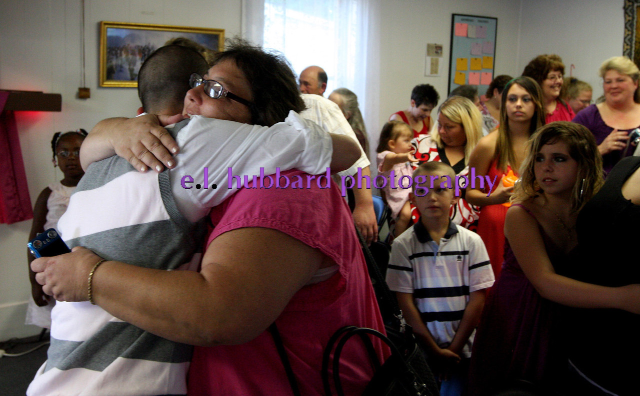 E.L. Hubbard photography<br /> Nathan Carberry hugs his mother-in-law, Christine Quimby, after the ceremony at New Life Ministries Tuesday, Aug. 16, 2011.