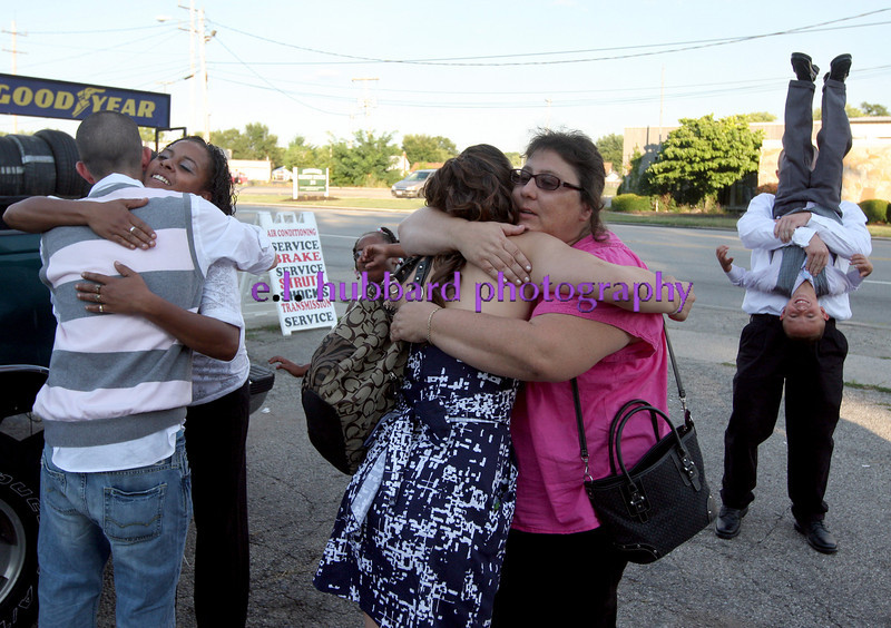 E.L. Hubbard photography<br /> Nathan Carberry hugs Rachel Overton and Kari Gregory hugs her mother, Christine Quimby, outside New Life Ministries in Hamilton after their wedding vows Tuesday, Aug. 16, 2011.  Robert Gregory, right, the fiance of Rachel Overton, holds her son, Jordan Overton, 5, upside down,