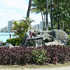 statue of a surfer and a seal - waikiki