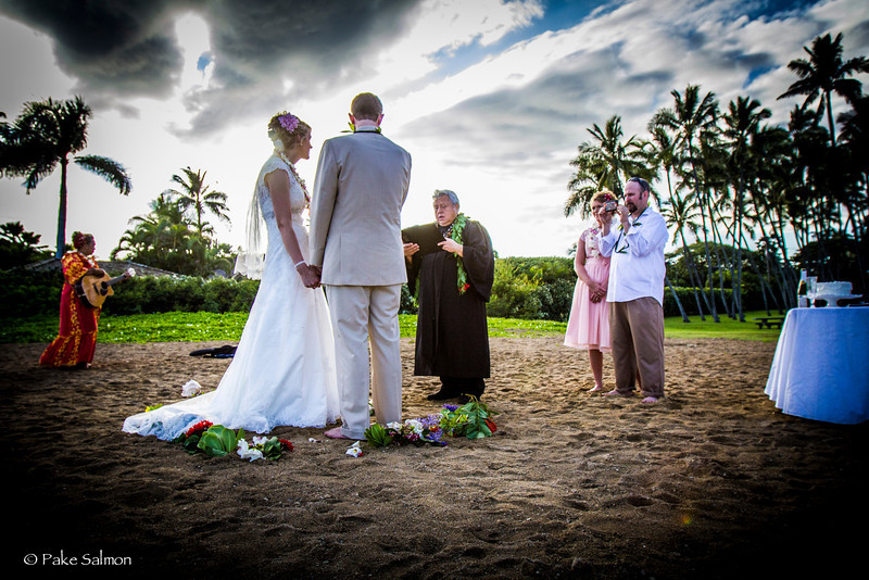 Hawaiian Style Beach Wedding, Waialae Beach, Oahu.  Jan. 2014.  Deluxe package that includes, cake, toasting, circle of flowers, & Hawaiian Music.  This package includes wedding photography and videography service in Hawaii.
