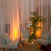 Soft furniture, sheer fabrics, orchids and palms set the tone for a relaxing evening in a historic venue.