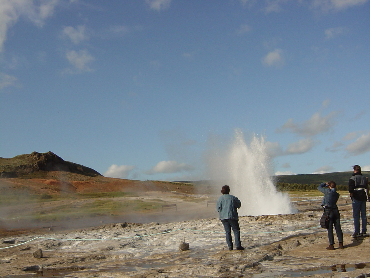 I am not sure how high the geysir spouts, but in the first picture you see the 'dieing down'f the first and highest spout.