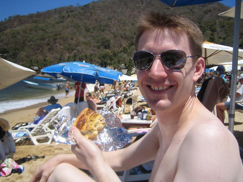 Jared enjoying his pie on the beach.