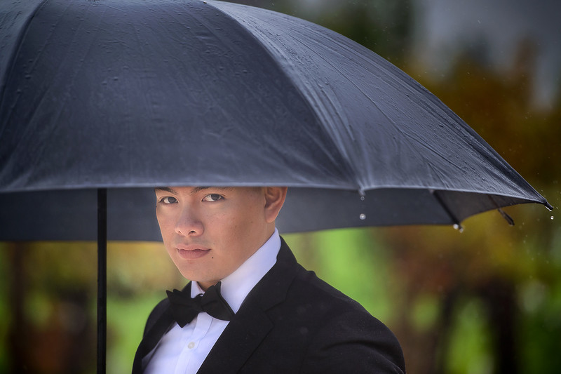 groom under the umbrella