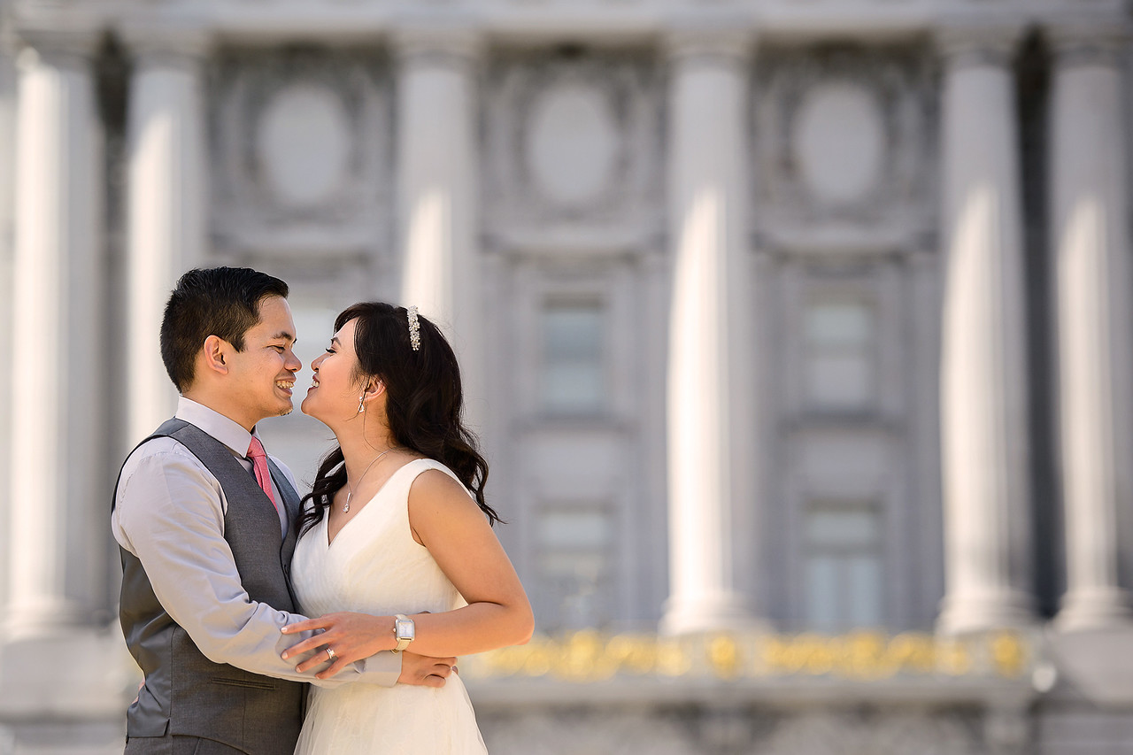 bride & groom in front of SF City Hall