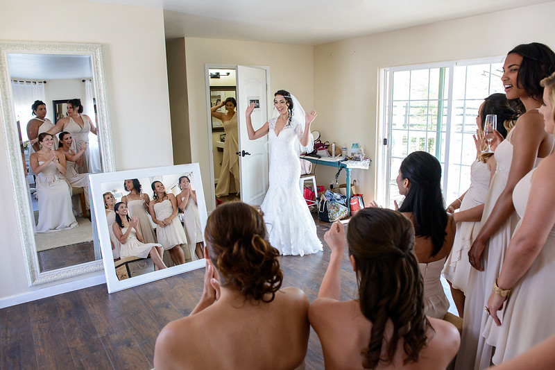 mirror shot of bride & bridesmaids