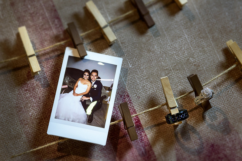 wedding rings on photo board