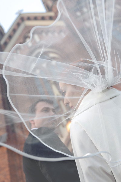 bride and groom in front of the church