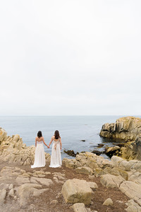 Brides holding hands at Lovers Point, facing the Pacific Ocean – Megan and Emily's Wedding @ The Perry House, Monterey
