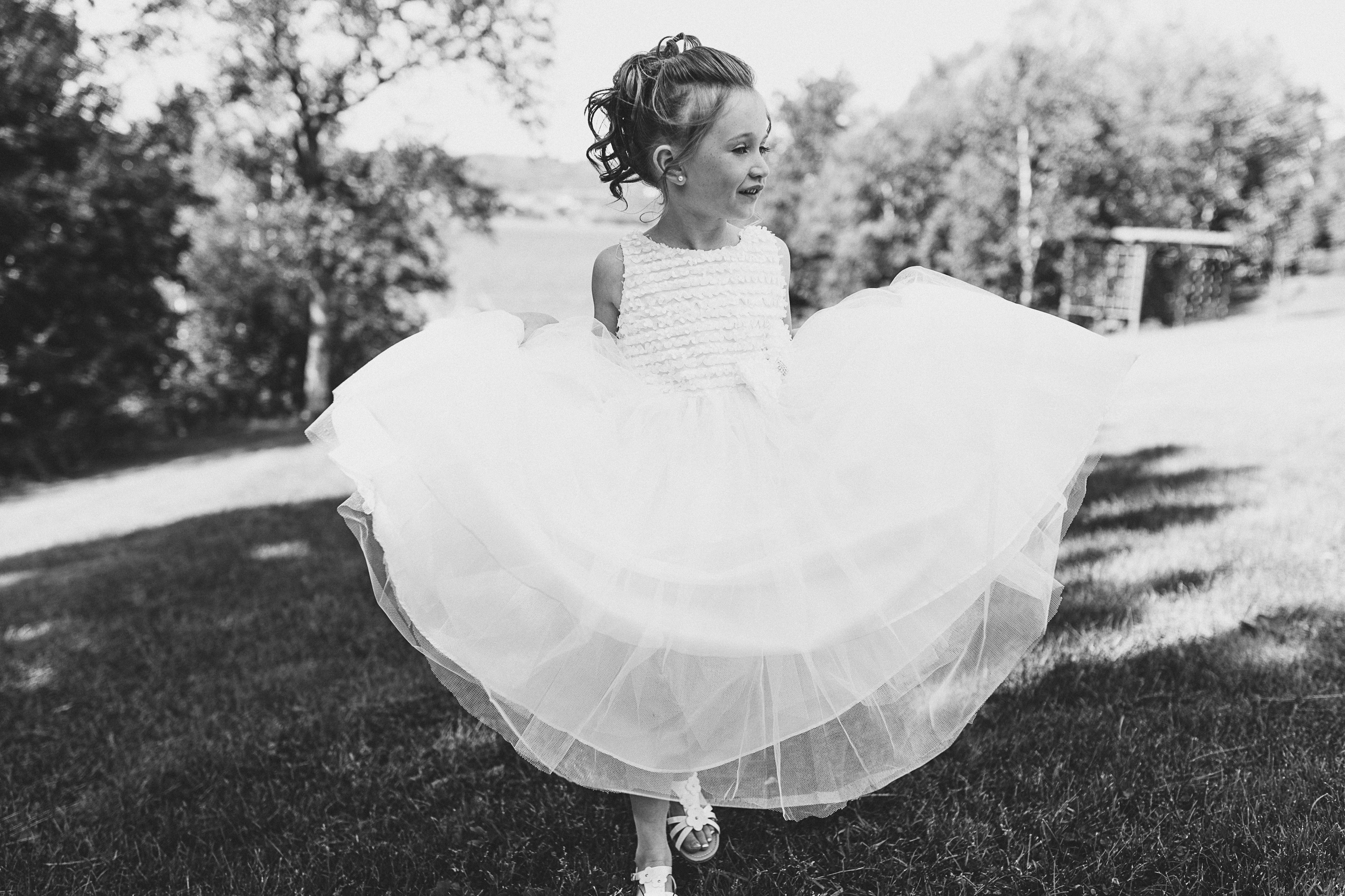 black and white wedding photo - flower girl