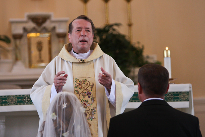 Priest gives the Homily