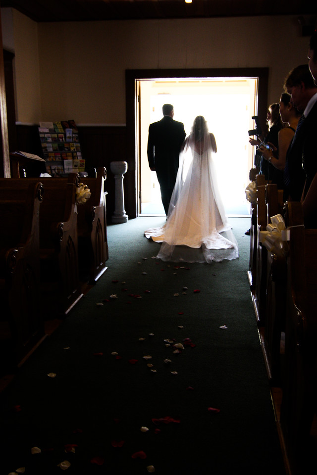 Ed and Jen leave the chapel.