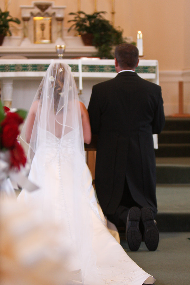 Kneeling at the altar