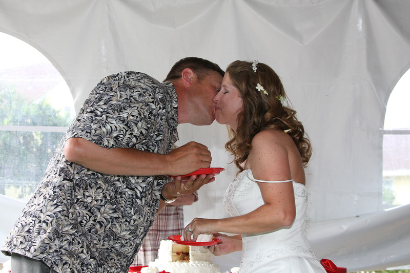 Ed and Jen feed each other the wedding cake