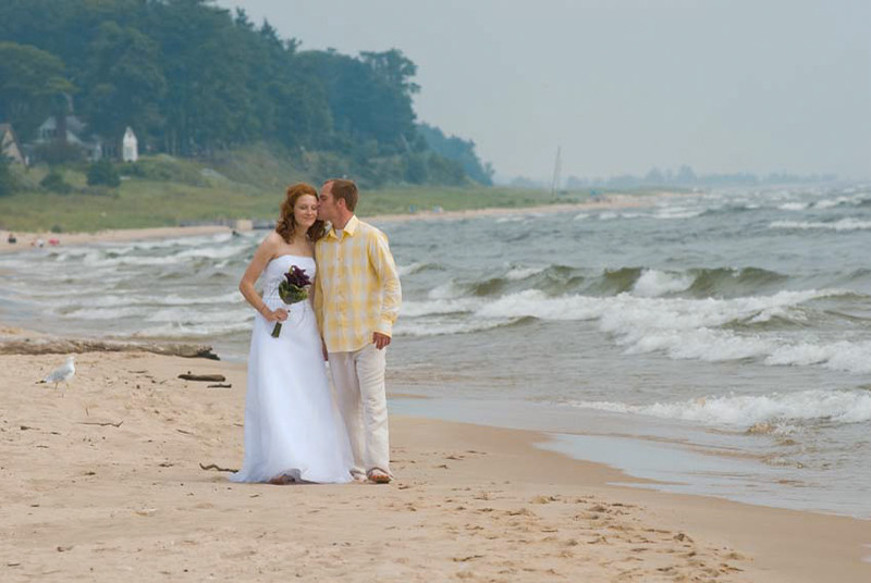 Beach wedding of Jessica & Michael. Pioneer County Park, Muskegon, Michigan. Reception Harbourfront, Grand Haven. Copyright Anthony Dugal Photography, Kalamazoo, Michigan, USA, (269) 349-6428.