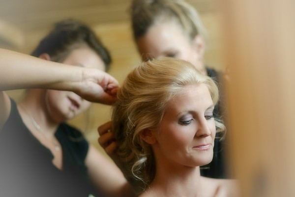 Our Amazing hair stylist puting on the finishing touches