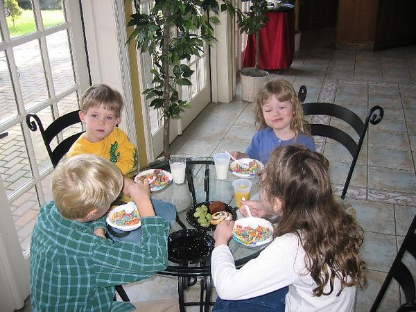 Kids eating breakfast at the hotel.