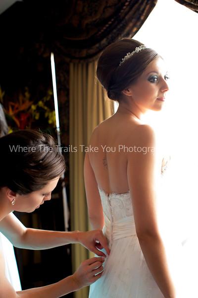 Buttoning Her Dress