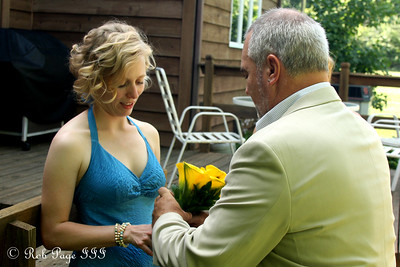 Showing Abby how to hold the bouquet of flowers - Chagrin Falls, OH ... June 27, 2009 ... Photo by Rob Page III