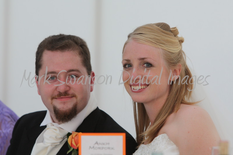Nick & Kate, now Mr & Mrs Thompson, sitting at the top table.