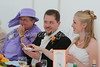Kate, Nick and his Mum at the top table.<br /> Nick is holding the cake figurine of the Bride that Kate made.