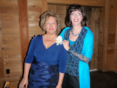 Jenny caught by surprise after pinning on Susan's corsage