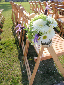 Beautiful flowers in Mason jars adorn the seating areas
