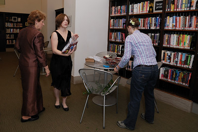 After the hair salon we went back to the library to continue setting things up.  Here we are assembling the cranberry/chrysanthemum center pieces.