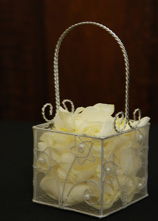 The flower girl's basket was filled with white rose petals.  This was a huge hit with the flower girl.