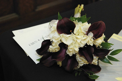 The bouquet was made from burgandy calililies and white hydrange