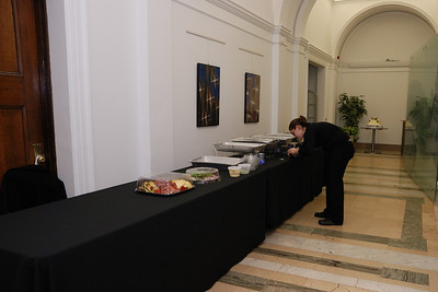 One of the two caterers setting up the buffet table.