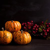 Orange pumpkins on the wooden backgound. Halloween, thanksgiving and autumn harvest concept with copy space
