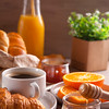 Breakfast with coffee, orange juice and croissant.