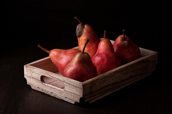Ripe fresh pears in the wooden box. Organic fruits concept