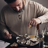 Bearded man eating oysters