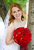 Kimberly Horton and Rhea Brown : Kimberly Horton and Rhea Brown wed Saturday June 21, 2008 at First Baptist Church in Tupelo MS.  Wow, what can I say about this one?  A georgeous red headed bride with a bright red bouquet of fresh roses, floral arrangements by Tracy Proctor designs, and a wonderful mix of friends and family.  I love shooting red heads.  With a camera of course :)  Rhea, you're quite the lucky fella...
