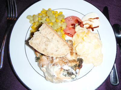 Buffet dinner: stuffed chicken, potatoes au gratin, succotash, etc.