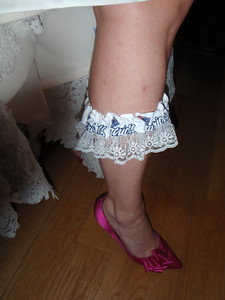 Under the wedding gown...Kris' New England Patriots garter and the hot pink shoes