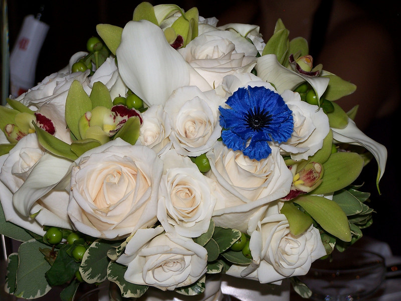 """Holly's bouquet, including the """"something blue"""" flower from Laurie's wedding bouquet."""