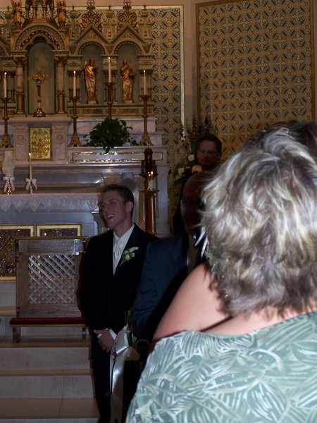 Kyle watching his bride come down the aisle