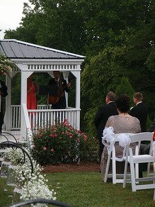 Lindsay Evans (Lauren's sister/maid of honor) and the best man sing a special song for the couple.