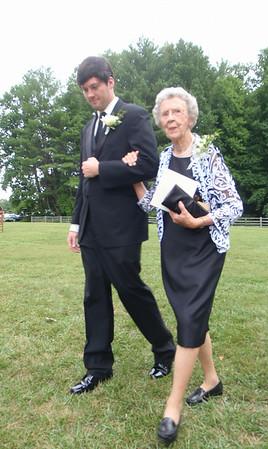 Ian (groom) escorted Mary Lee (bride's grandma) down the aisle.