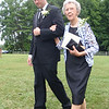 Ian (groom) escorted Mary Lee (bride's grandma) down the aisle.