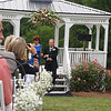 Patricia and Sammy exit the gazebo after lighting the unity candle.