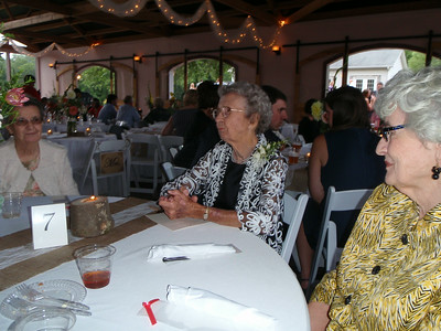 Beth, Mary Lee, and Mom await the start of dinner.