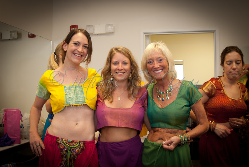 lol.....the story behind this photo is that these lovely ladies are wearing their tops backwards ;)