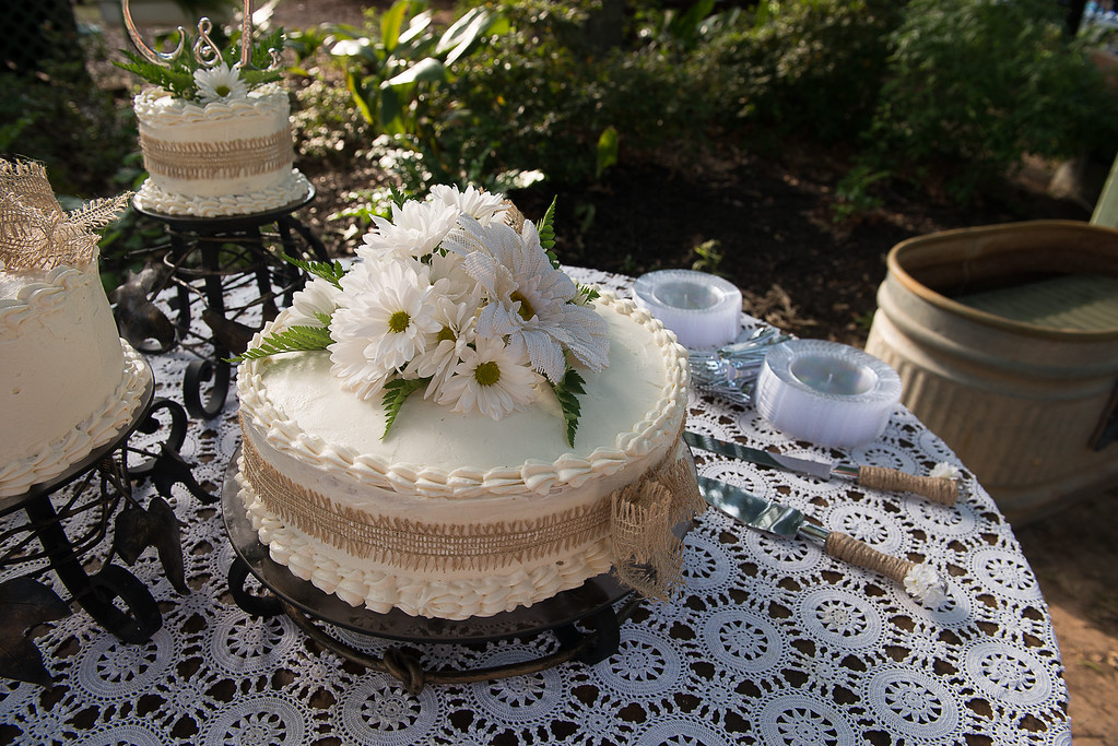 This is a traditional white wedding cake with cream cheese icing. I used a cake mix but kicked it up a notch and it was so moist and delicious!