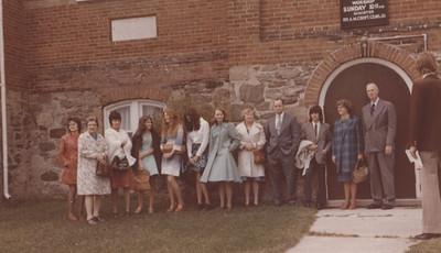From L to R: Carey MacInnes, Grandma MacInnes, Doreen MacInnes, Carol MacInnes, Karen Irwin, Anne Mouland, Pat Hrycyna, Daisy Ferguson, Vern Ferguson, Wayne Pedwell, Lorna Pearson, Bob Pearson.