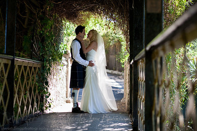 Preparations began at a private villa in San Pedro. As Nicola had her hair and makeup prepared by the fabulous Kathryn Parr a nervous Colin was getting dressed downstairs in his Scottish attire. In separate transport it was then onto the stunning Botanical Gardens of Gibraltar for the ceremony. As Nicola, her father and bridesmaids accompanied by a Scotish bagpiper entered the dell tears were held back. After a moving ceremony and a walk around the gardens it was back to the villa for cocktails and canapes. With a beautiful sunset developing we took a stroll down to the beach for some more photographs. As the darkness drew in a lavish dinner was enjoyed by all. A big thank you to Jan and Kath of JK wedding Planners for planning a lovely day.