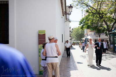 The atmosphere was very chilled and relaxed as I entered the room at the Hotel Marinas in Nerja. As Jennifer was having her hair and make up prepared the bridesmaid played cards. Meanwhile waiting at El Salvador Chruch in Nerja a not so relaxed Brian was nervously awaiting his bride. As Jennifer entered the Church with her father Brian was holding back his emotions. After a moving ceremony and a a short walk around Nerja it was back to the Hotel Marinas de Nerja for the celebrations. Following drinks and canapes and a few more photographs it was onto the beach front for a stunning sea view dinner. Evening celebrations began with music by the band Monkey Tennis and then went on into the early hours in the morning. A big thank you to Jennifer and Joan of Spanish Wedding Planner for organizing a fabulous day